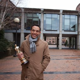 TJ Martin holds Oscar in front of Sky Bridge