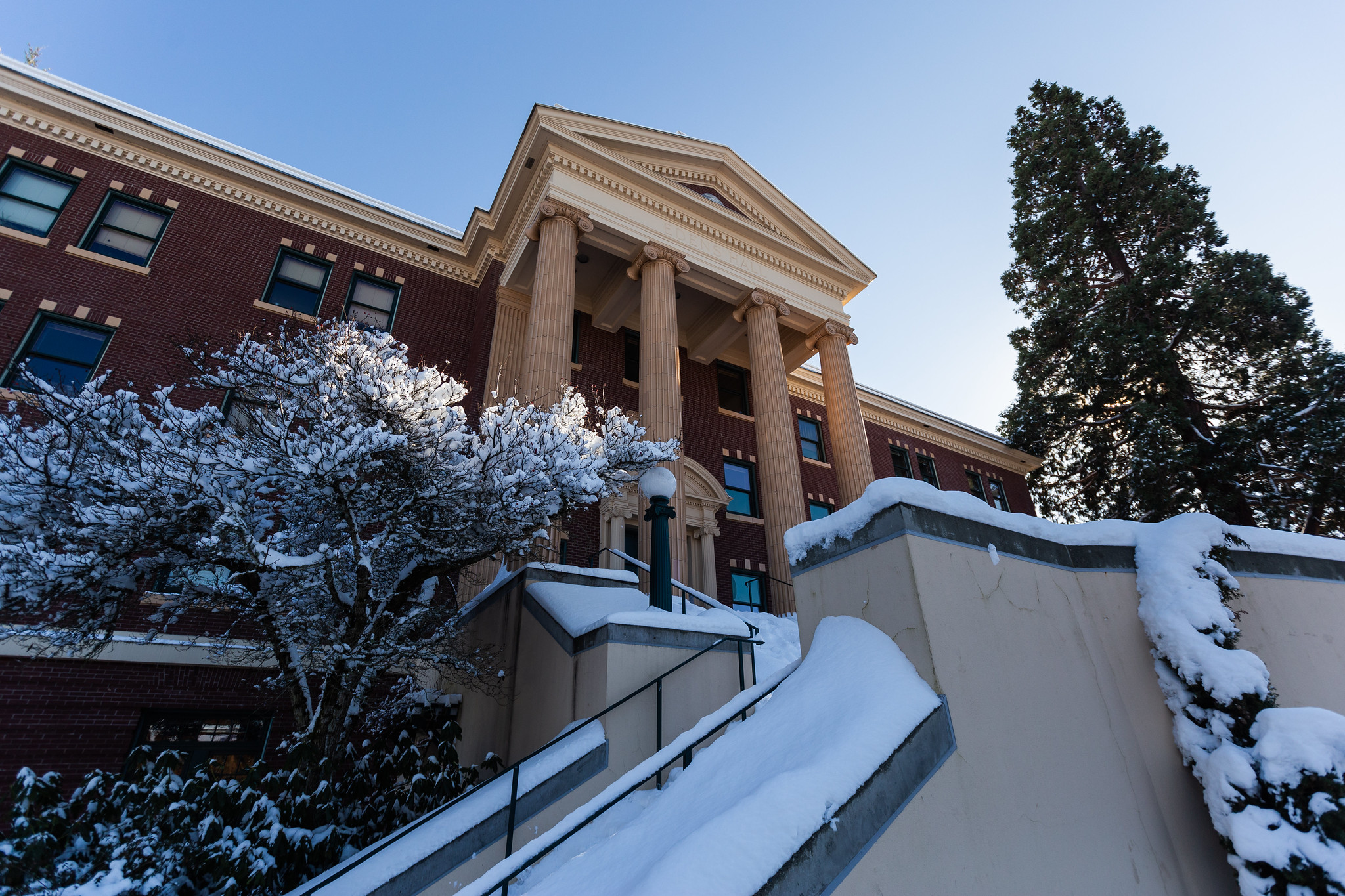 Edens Hall covered in a thin blanket of clean white snow