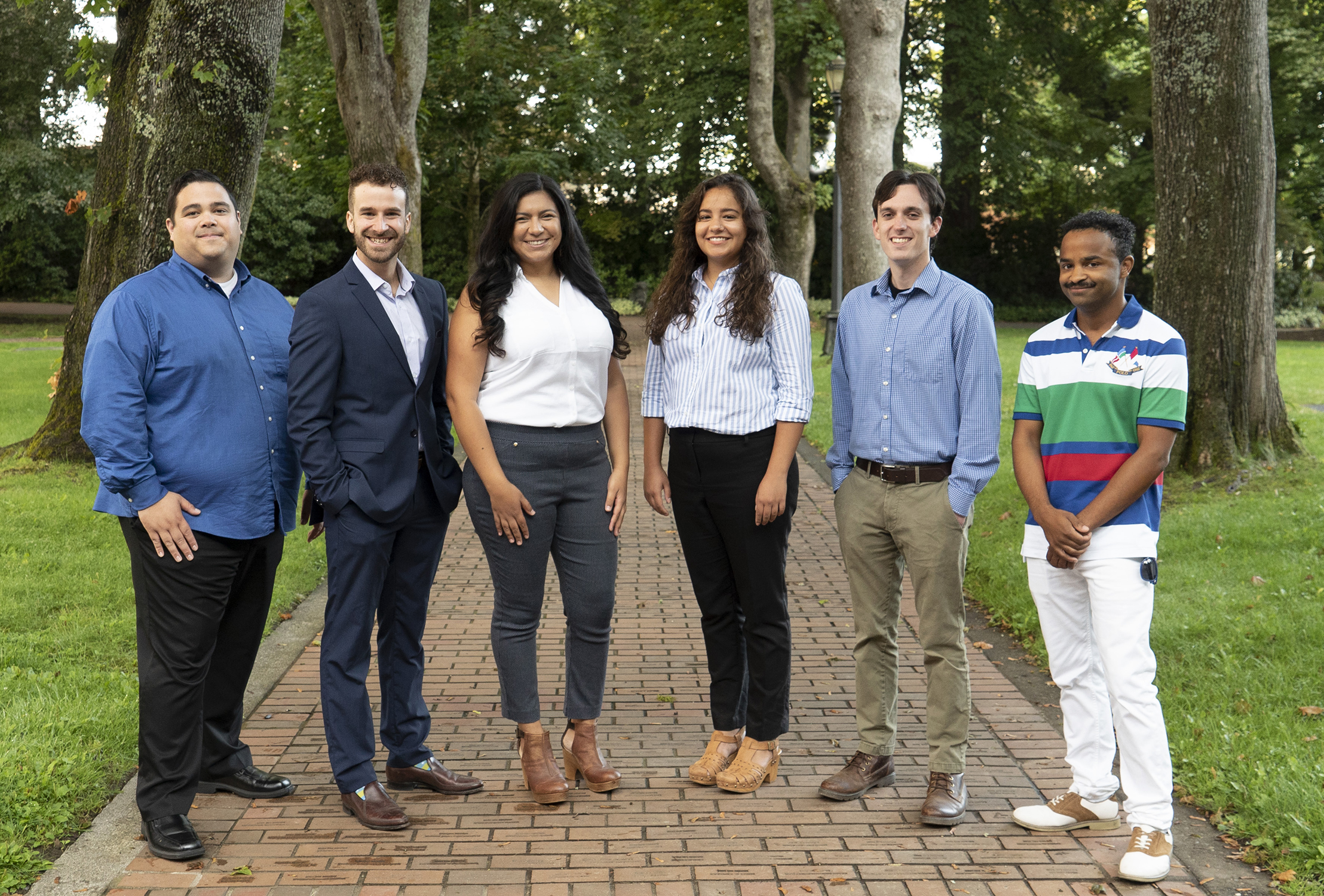 Six Western Admissions Counselors stand side-by-side smiling at the camera.