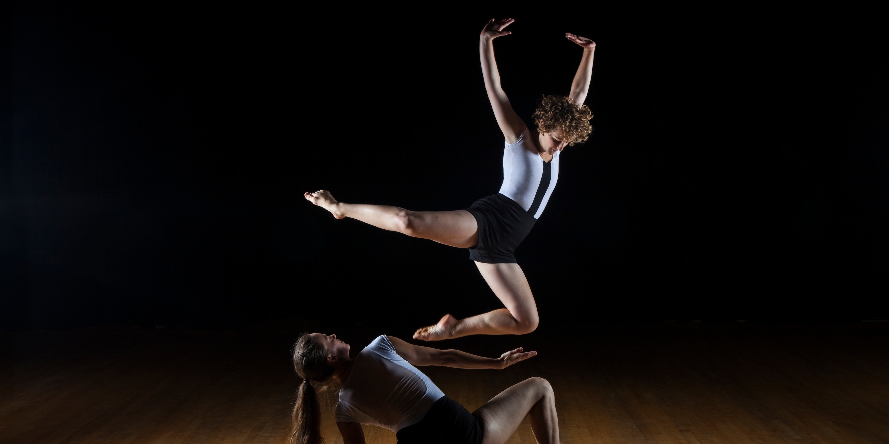 Dancers performing a dramatic piece on stage