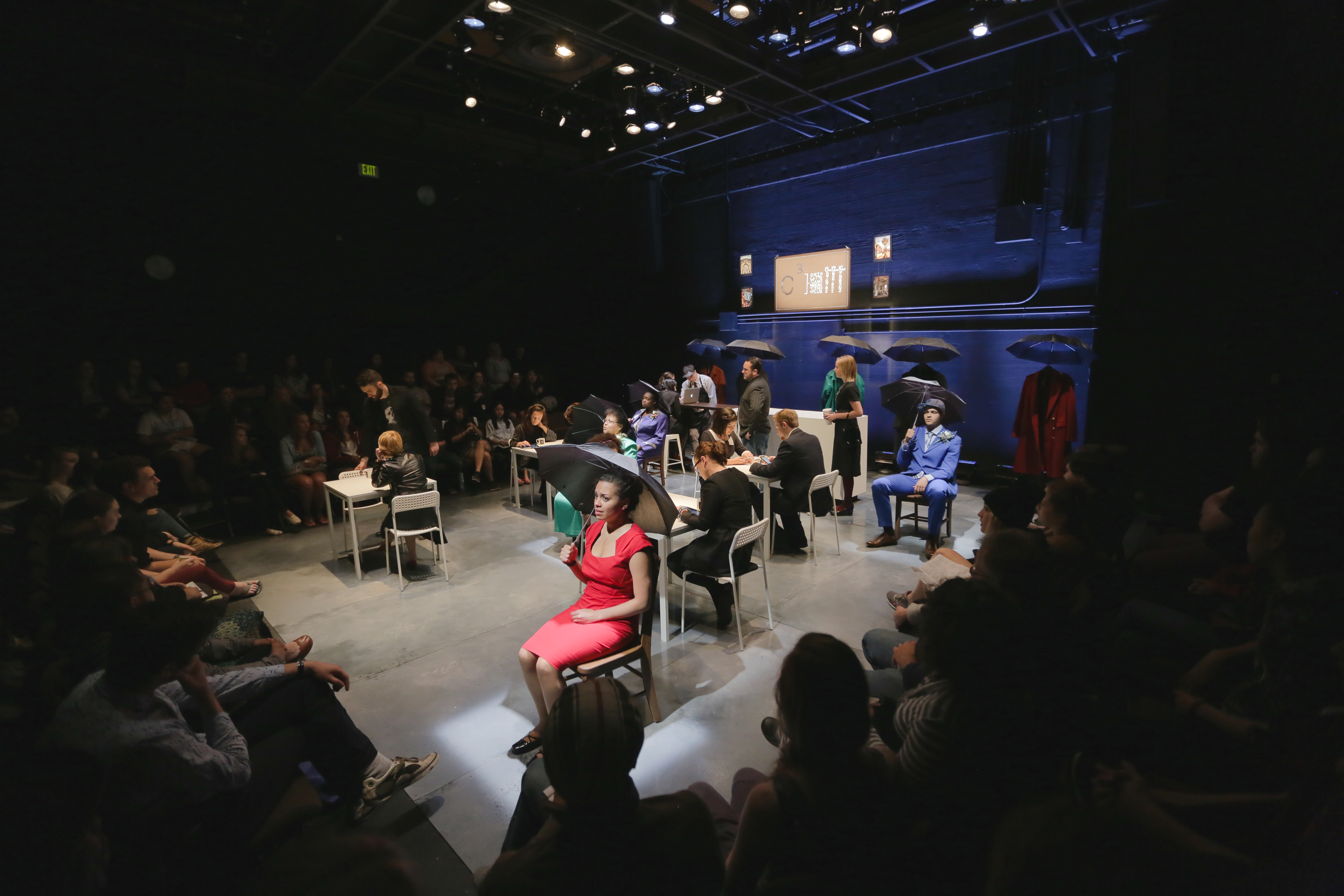 Students performing a play in the DUG Theater