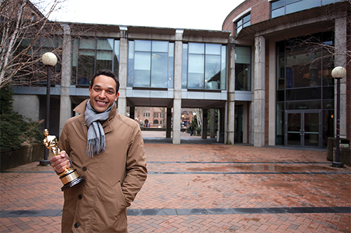 TJ Martin stands in front of Haggard Hall with his Academy Award