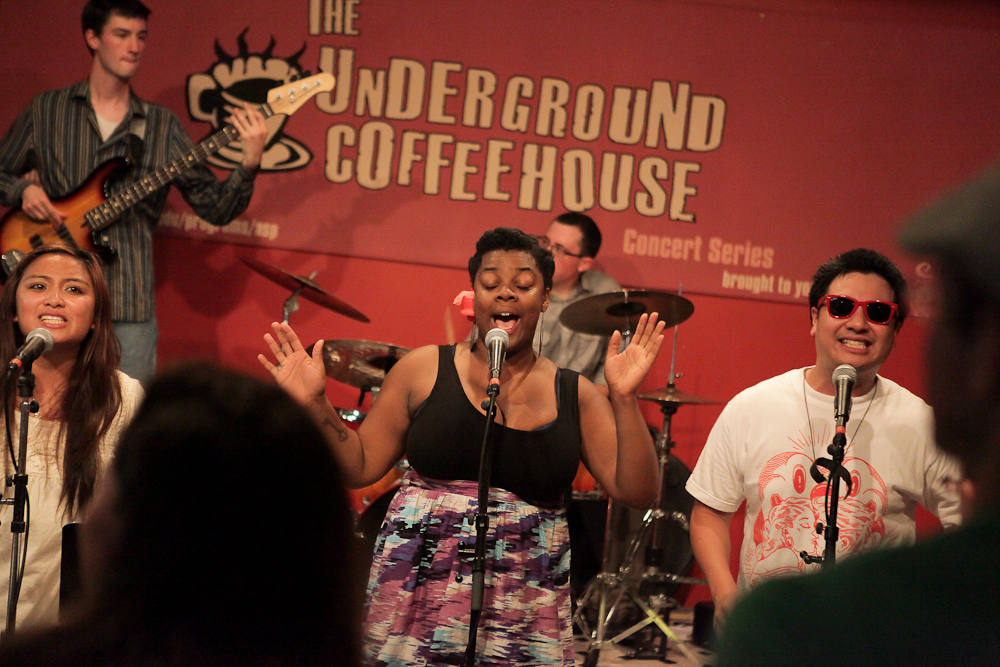 A band performing in the Underground Coffeehouse on campus