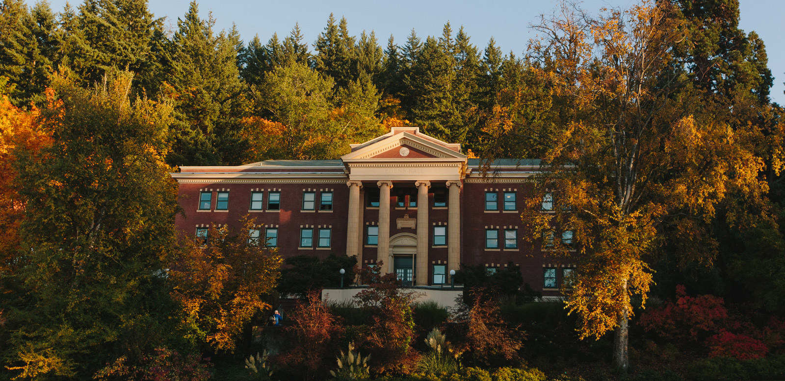 Edens Hall in the fall at sunset.