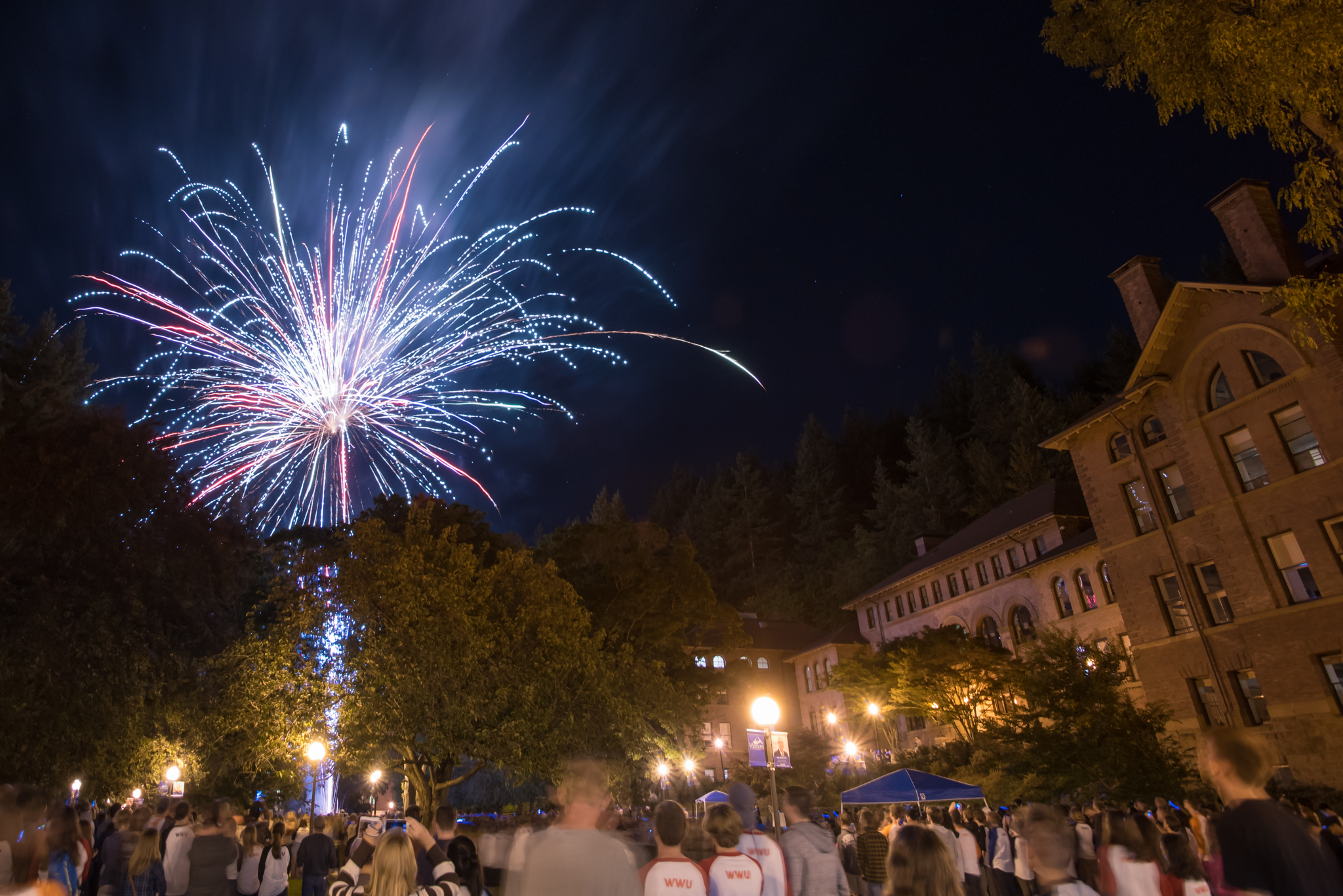 Fireworks light up the sky in front of Old Main.