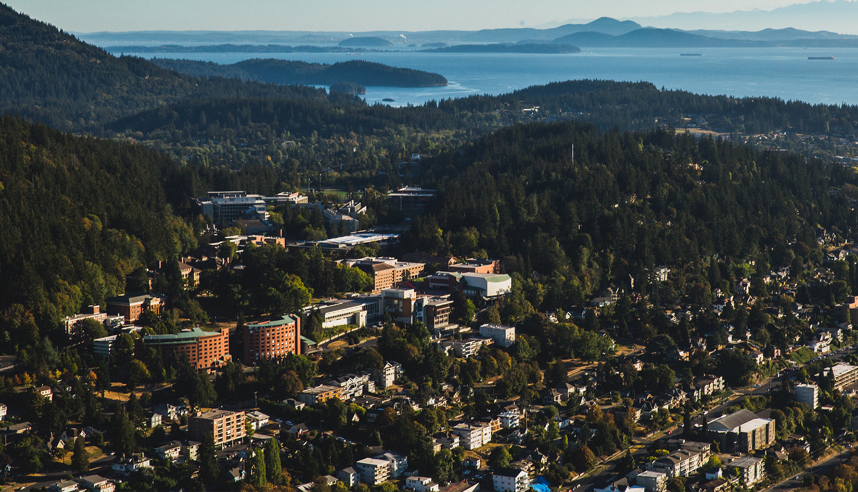 The WWU campus as seen from above, with Bellingham Bay in the background