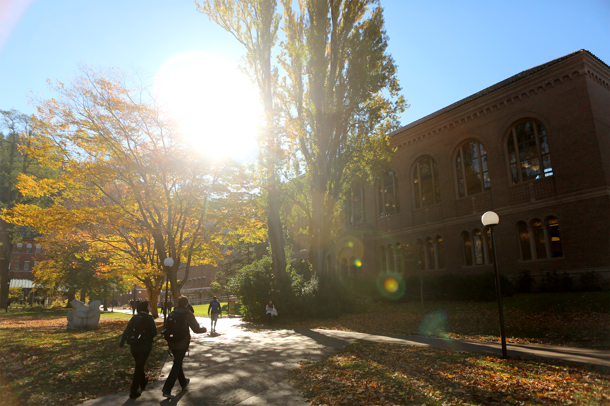Students walking onto campus in the fall.