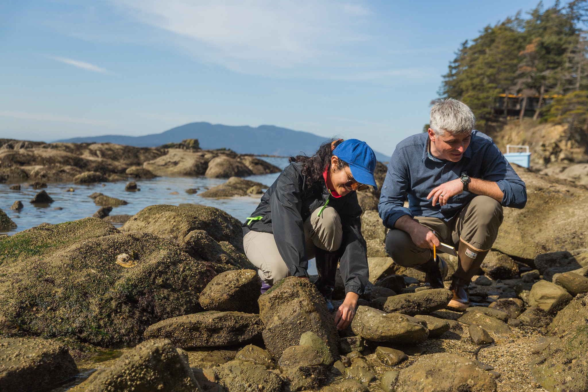 Dr. Marco Hatch, a Samish Indian Nation member, and Assistant Professor at Western Washington University working with an undergraduate research student in local tidal pools.