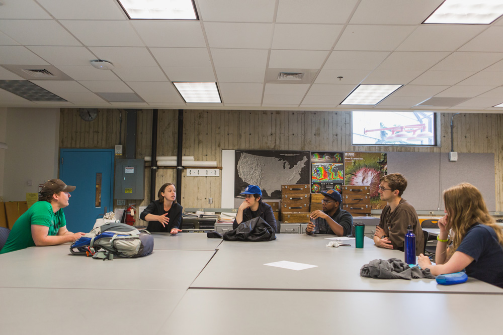 Dr. Melissa Rice and students in a geology classroom.